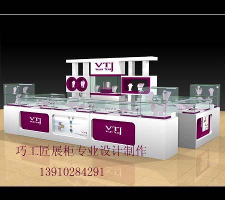 供应珠宝展柜 展柜设计 展柜制作 本厂成立于2000年,是北京地区一家专业从事,商业展台、展柜,商场展柜.设计制作的新型专业制造厂。   主要设计制作黄金珠宝精品柜台,化妆品形象展柜,电子卖场展柜,服饰鞋帽展柜,饰品展柜,食品展柜,服装展柜,钢木结构组装展柜,超市整体卖场木质展柜制作,更有丰富的精品店,服饰店设计装修,商场及大卖场整体统装商装经验。   现已长年与北京苏宁电器集团,美廉美超市集团,亿客隆超市,家乐福超市,汇美舍华北区代理公司,美国GOLF皮具北京总代理,汇百家公司,金香阁食品公司,怡莲床上
